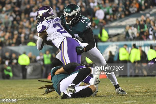 Minnesota Vikings running back Jerick McKinnon is tackled by Philadelphia Eagles defensive back Corey Graham and Philadelphia Eagles cornerback...