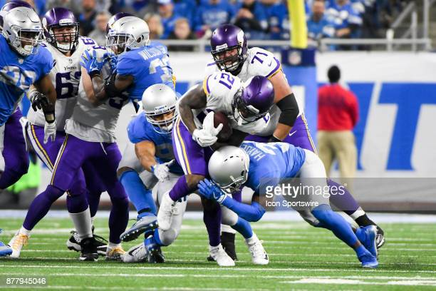 Minnesota Vikings running back Jerick McKinnon runs for a few yards as he's tackled by Detroit Lions defensive back DJ Hayden during the Detroit...