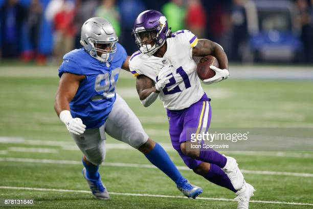 Minnesota Vikings running back Jerick McKinnon runs with the ball while being pursued by Detroit Lions defensive tackle Jeremiah Ledbetter during...