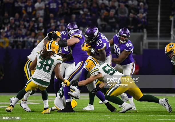 Minnesota Vikings Running Back Latavius Murray is brought down by Green Bay Packers Linebacker Blake Martinez during an NFL game between the...