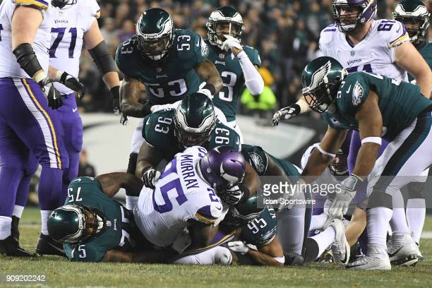 Minnesota Vikings running back Latavius Murray is tackled by a host of Philadelphia Eagles during the NFC Championship game between the Philadelphia...