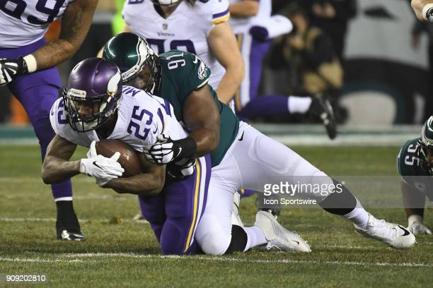 Minnesota Vikings running back Latavius Murray is tackled for a loss y Philadelphia Eagles defensive tackle Fletcher Cox during the NFC Championship...