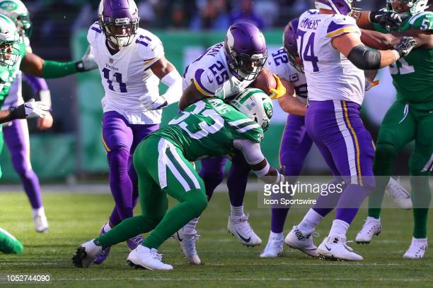 Minnesota Vikings running back Latavius Murray runs against New York Jets strong safety Jamal Adams during the National Football League Game between...