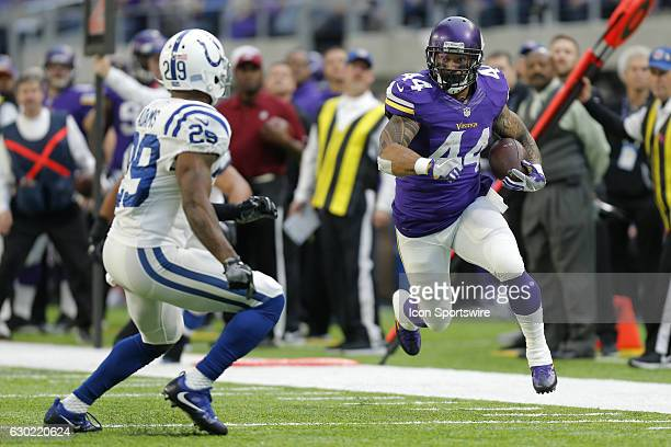 Minnesota Vikings Running Back Matt Asiata looks to get past Indianapolis Colts Safety Mike Adams during an NFL football game between the...