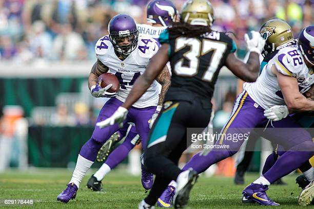 Minnesota Vikings Running Back Matt Asiata runs for a gain during the NFL game between the Minnesota Vikings and the Jacksonville Jaguars on December...