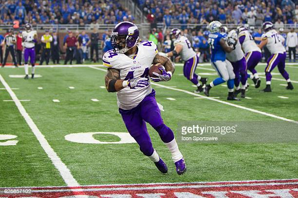 Minnesota Vikings running back Matt Asiata runs with the ball during game action between the Minnesota Vikings and the Detroit Lions on Thanksgiving...