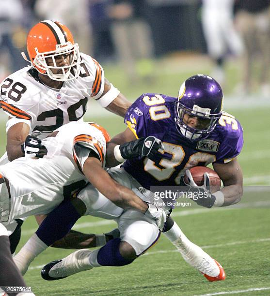 Minnesota Vikings running back Mewelde Moore is brought down during a game against the Cleveland Browns on November 27 2005 in the Metrodome in...