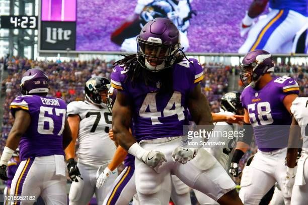 Minnesota Vikings running back Mike Boone celebrates after scoring a rushing touchdown in the 3rd quarter to make it 107 Vikings during the preseason...