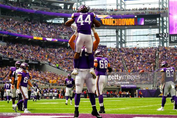 Minnesota Vikings running back Mike Boone celebrates with offensive tackle Brian O'Neill after Boone scored a rushing touchdown in the 3rd quarter...