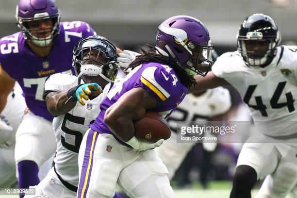 Minnesota Vikings running back Mike Boone rushes during the preseason game between the Jacksonville Jaguars and the Minnesota Vikings on August 18...