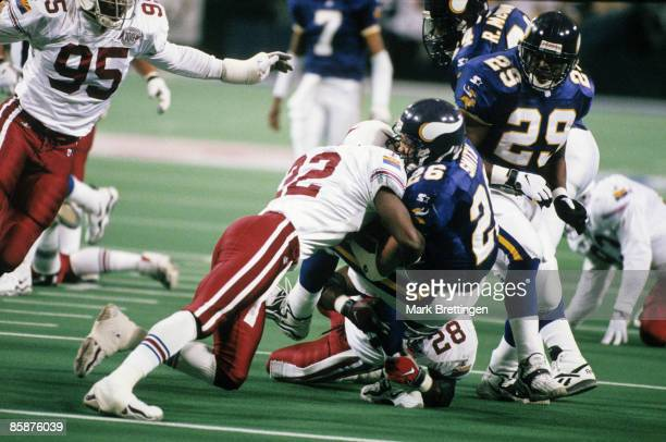 Minnesota Vikings running back Robert Smith carries the football and gets hit hard by Cardinals cornerback Tom Knight during the Vikings 41-21...
