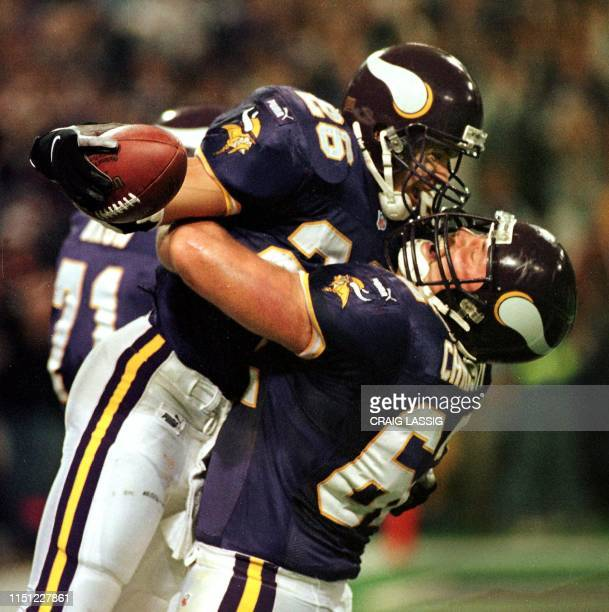 Minnesota Vikings running back Robert Smith celebrates with teammate Jeff Christy after Smith scored a touchdown on a 26yard Jeff George pass in the...