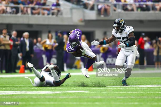 Minnesota Vikings running back Roc Thomas is tackled during the preseason game between the Jacksonville Jaguars and the Minnesota Vikings on August...