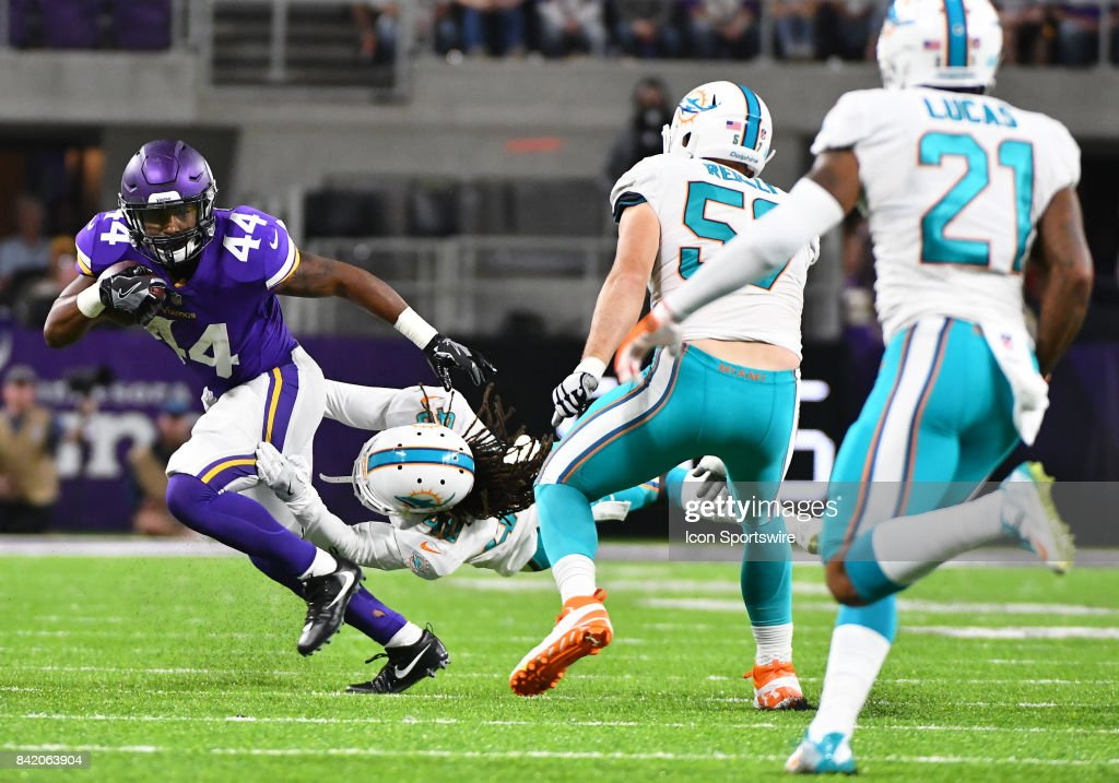 Minnesota Vikings running back Terrell Newby (44) shakes off Miami Dolphins cornerback Lafayette Pitts (40) during a NFL preseason game between the Minnesota Vikings and Miami Dolphins on August 31, 2017 at U.S. Bank Stadium in Minneapolis, MN. The Dolphins defeated the Vikings 30-9.