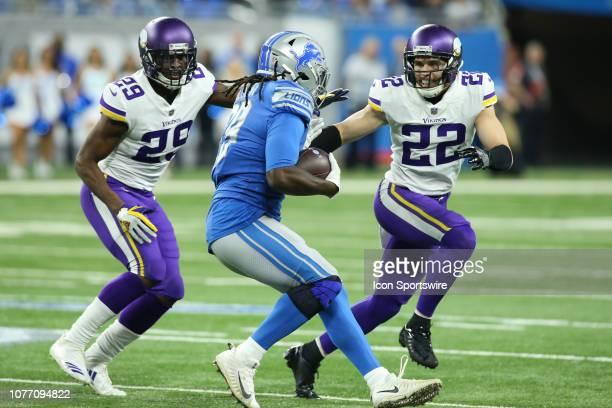 Minnesota Vikings safety Harrison Smith and Minnesota Vikings corner back Xavier Rhodes converge on Detroit Lions running back LeGarrette Blount...