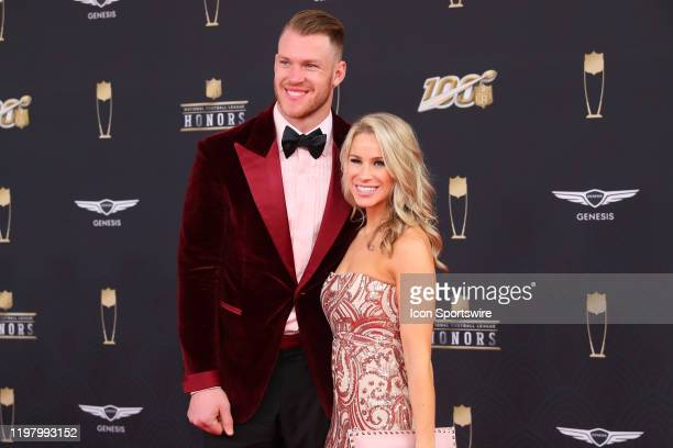 Minnesota Vikings tight end Kyle Rudolph and Jordan Nine pose prior to the NFL Honors on February 1 2020 at the Adrienne Arsht Center in Miami FL