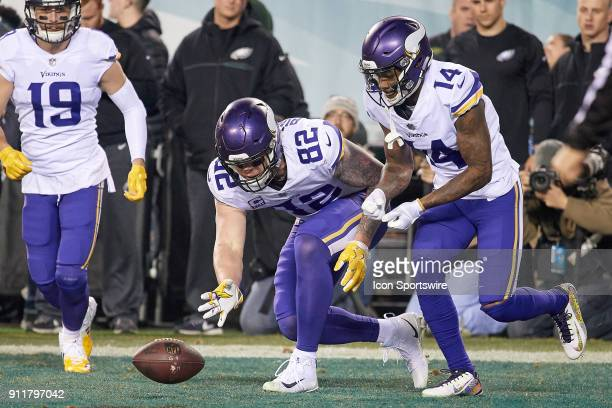 Minnesota Vikings tight end Kyle Rudolph celebrates with Minnesota Vikings wide receiver Stefon Diggs by pretending to play a game of Curling with...