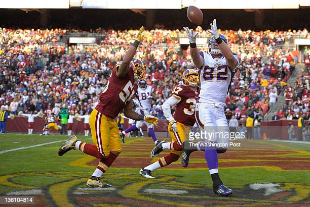 Minnesota Vikings tight end Kyle Rudolph hauls in a touchdown pass over Washington Redskins inside linebacker Perry Riley and Washington Redskins...