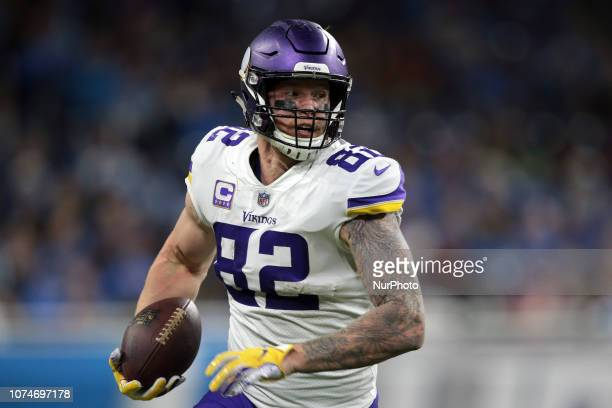 Minnesota Vikings tight end Kyle Rudolph runs the ball during the second half of an NFL football game against the Detroit Lions in Detroit Michigan...