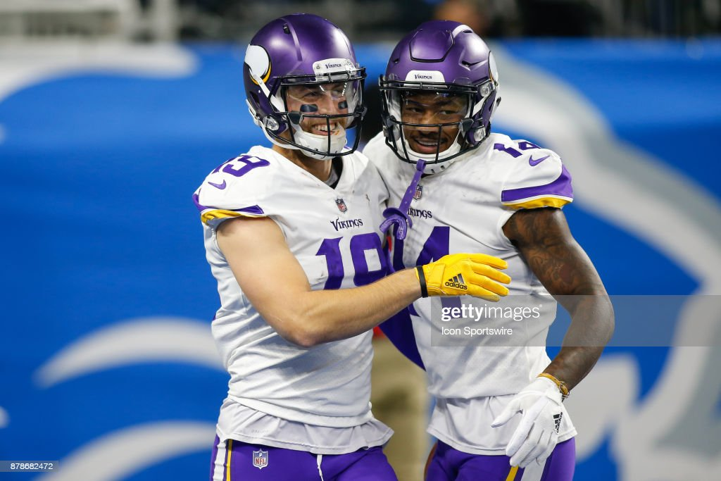 Minnesota Vikings wide receiver Adam Thielen (19) and Minnesota Vikings wide receiver Stefon Diggs (14) celebrate a score during game action between the Minnesota Vikings and the Detroit Lions on November 23, 2017 at Ford Field in Detroit, Michigan.