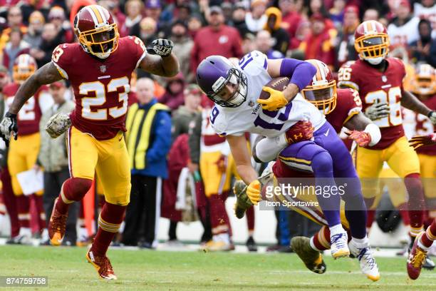 Minnesota Vikings wide receiver Adam Thielen catches a pass in the second quarter and is brought down by Washington Redskins inside linebacker Will...