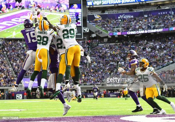 Minnesota Vikings wide receiver Adam Thielen goes up for a Hail Mary at the end of a half as Green Bay Packers cornerback Josh Hawkins Green Bay...