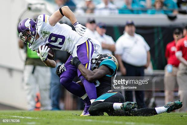 Minnesota Vikings Wide Receiver Adam Thielen is tackled by Jacksonville Jaguars Linebacker Telvin Smith during the NFL game between the Minnesota...