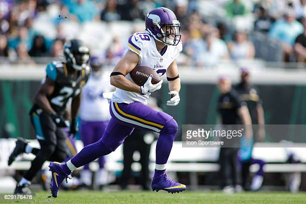 Minnesota Vikings Wide Receiver Adam Thielen runs for a gain during the NFL game between the Minnesota Vikings and the Jacksonville Jaguars on...