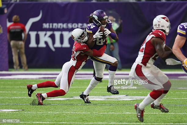 Minnesota Vikings wide receiver Cordarrelle Patterson runs with the ball as he is tackled by Arizona Cardinals cornerback Justin Bethel during a game...