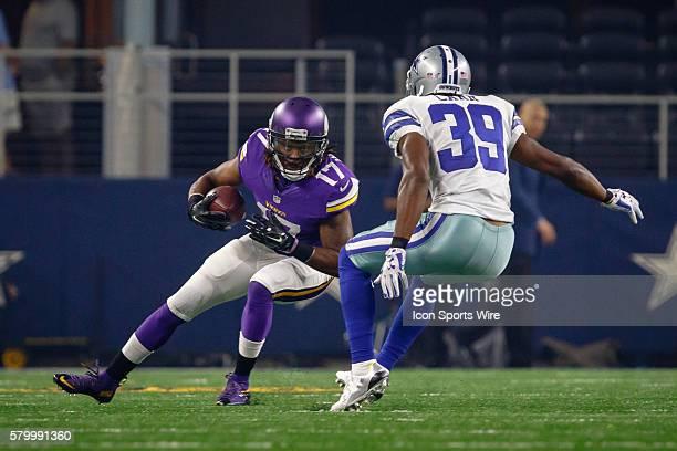Minnesota Vikings wide receiver Jarius Wright attempts to make a cut back against Dallas Cowboys cornerback Brandon Carr during the NFL preseason...