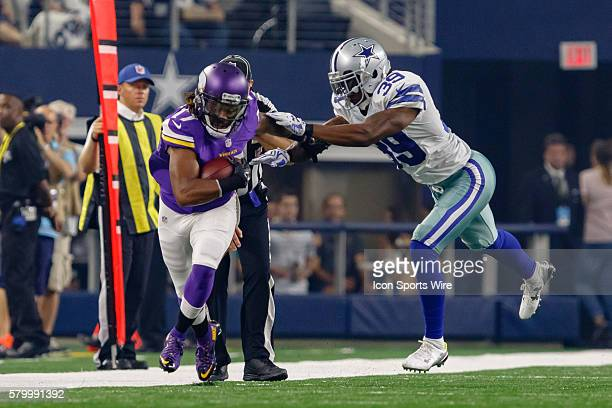 Minnesota Vikings wide receiver Jarius Wright makes a catch with Dallas Cowboys cornerback Brandon Carr defending during the NFL preseason game...