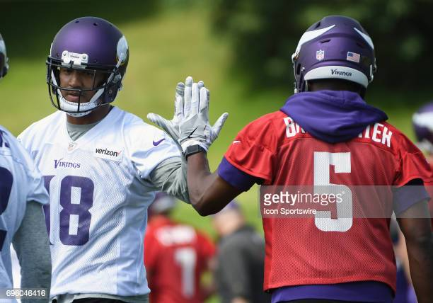 Minnesota Vikings wide receiver Michael Floyd Minnesota Vikings quarterback Teddy Bridgewater highfive during Minnesota Vikings Minicamp on June 14...