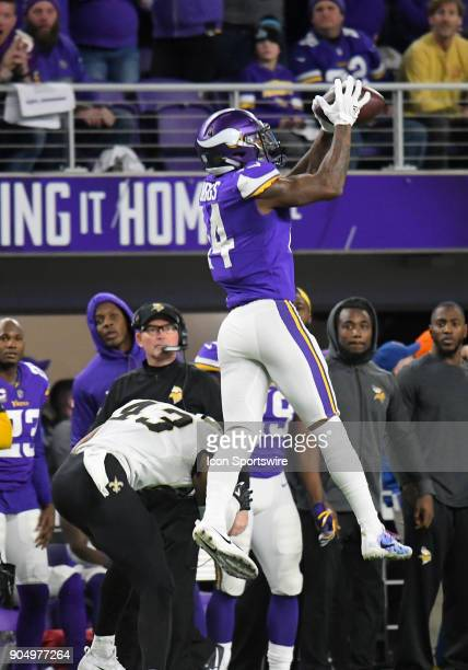 Minnesota Vikings wide receiver Stefon Diggs catches a pass he would run to the end zone for the gamewinning score during a NFC Divisional Playoff...