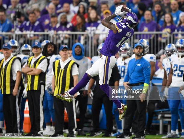 Minnesota Vikings wide receiver Stefon Diggs catches the ball for a first down against the Detroit Lions during the first quarter at US Bank Stadium...