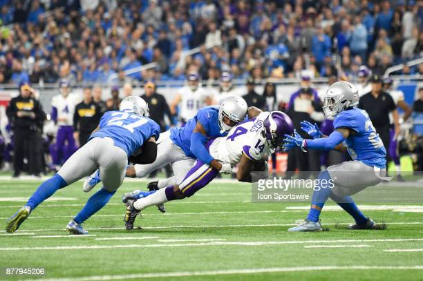 Minnesota Vikings wide receiver Stefon Diggs dives for more yards and a first down as he's tackled by Detroit Lions linebacker Jarrad Davis during...