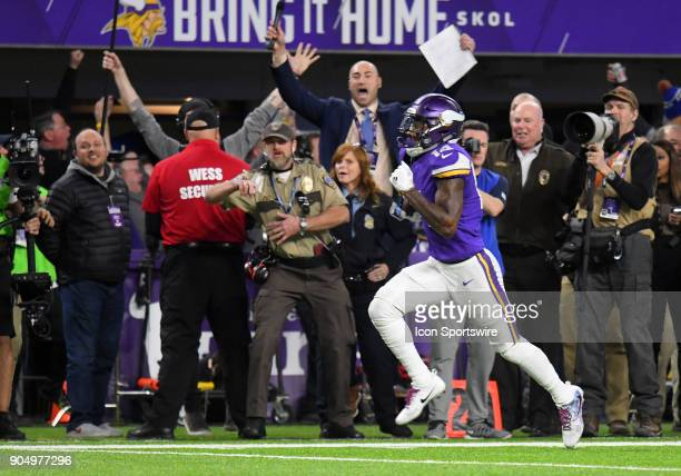 Minnesota Vikings wide receiver Stefon Diggs heads for the end zone for the game winning touchdown during a NFC Divisional Playoff game between the...