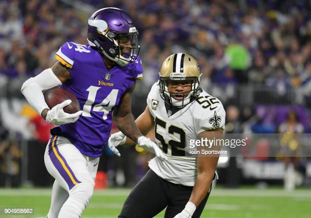 Minnesota Vikings wide receiver Stefon Diggs runs after the catch as New Orleans Saints linebacker Craig Robertson gives chase during a NFC...