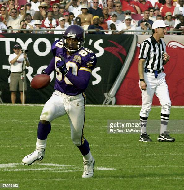 Minnesota wide receiver Cris Carter with a reception in a 4113 Vikings loss to the Tampa Bay Buccaneers at Raymond James Stadium on October 29 2000