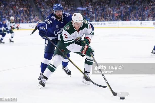 Minnesota Wild center Charlie Coyle is defended by Tampa Bay Lightning right wing Nikita Kucherov in the first period of the NHL game between the...