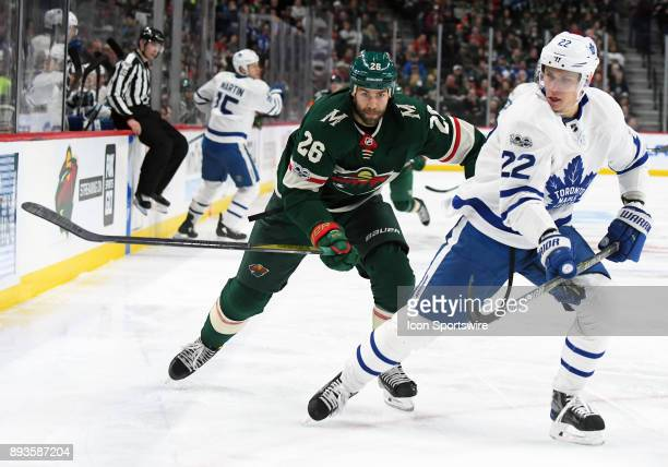 Minnesota Wild Center Daniel Winnik and Toronto Maple Leafs Defenceman Nikita Zaitsev race after a loose puck during a NHL game between the Minnesota...