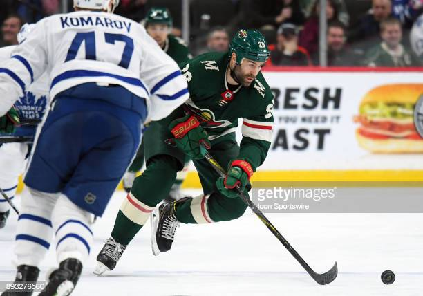 Minnesota Wild Center Daniel Winnik skates the puck up ice during a NHL game between the Minnesota Wild and Toronto Maple Leafs on December 14 2017...