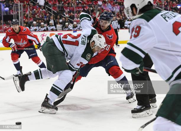 WASHINGTON DC MARCH Minnesota Wild center Eric Fehr and Washington Capitals center Lars Eller battle for the puck during a face off in the first...