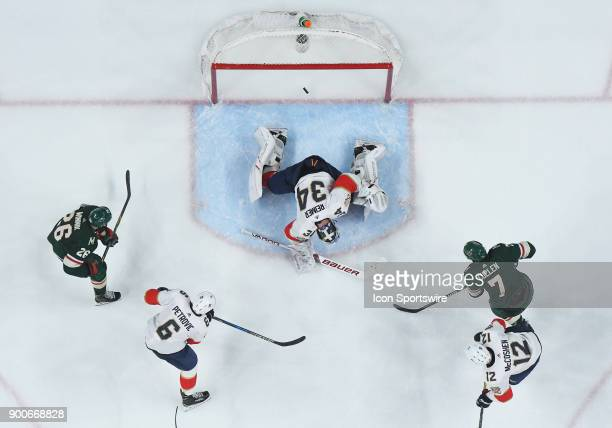 Minnesota Wild Center Matt Cullen beats Florida Panthers Goalie James Reimer for his 2nd goal of the night during a NHL game between the Minnesota...