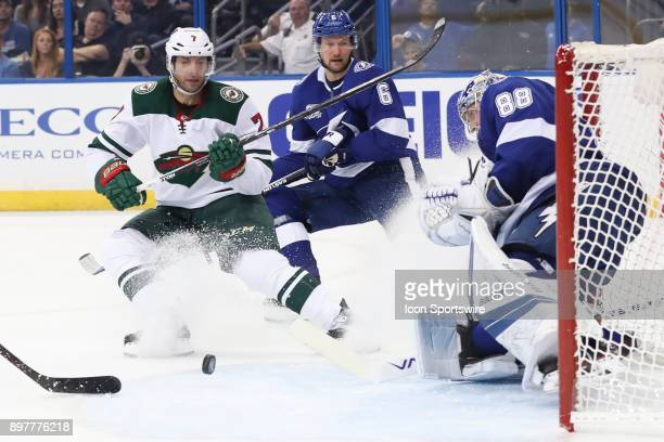 Minnesota Wild center Matt Cullen tries to get the rebound after Tampa Bay Lightning goalie Andrei Vasilevskiy blocked his shot in the first period...