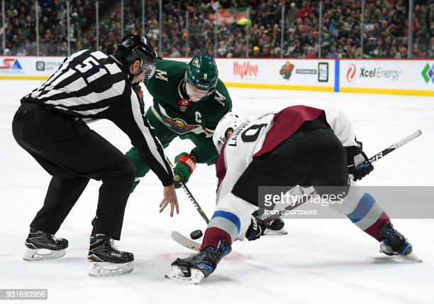 Minnesota Wild Center Mikko Koivu and Colorado Avalanche Left Wing Gabriel Landeskog faceoff during a NHL game between the Minnesota Wild and...