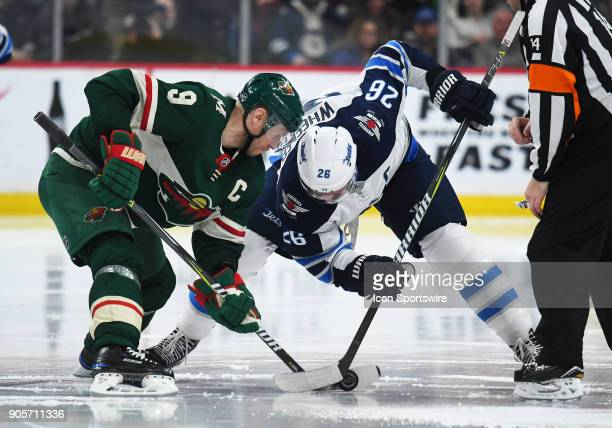 Minnesota Wild Center Mikko Koivu and Winnipeg Jets Center Blake Wheeler faceoff during a NHL game between the Minnesota Wild and Winnipeg Jets on...
