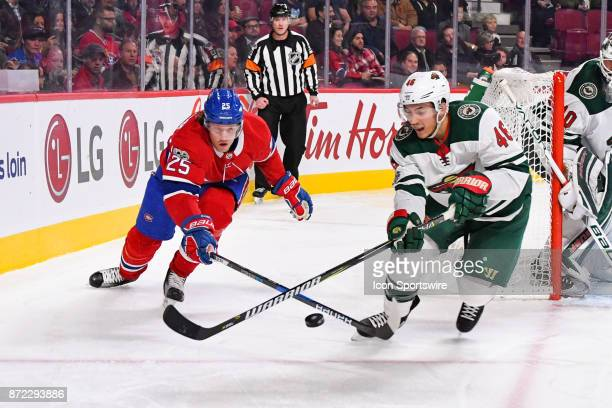 Minnesota Wild Defenceman Jared Spurgeon and Montreal Canadiens Center Jacob De La Rose reaching out to gain control of the puck during the Minnesota...