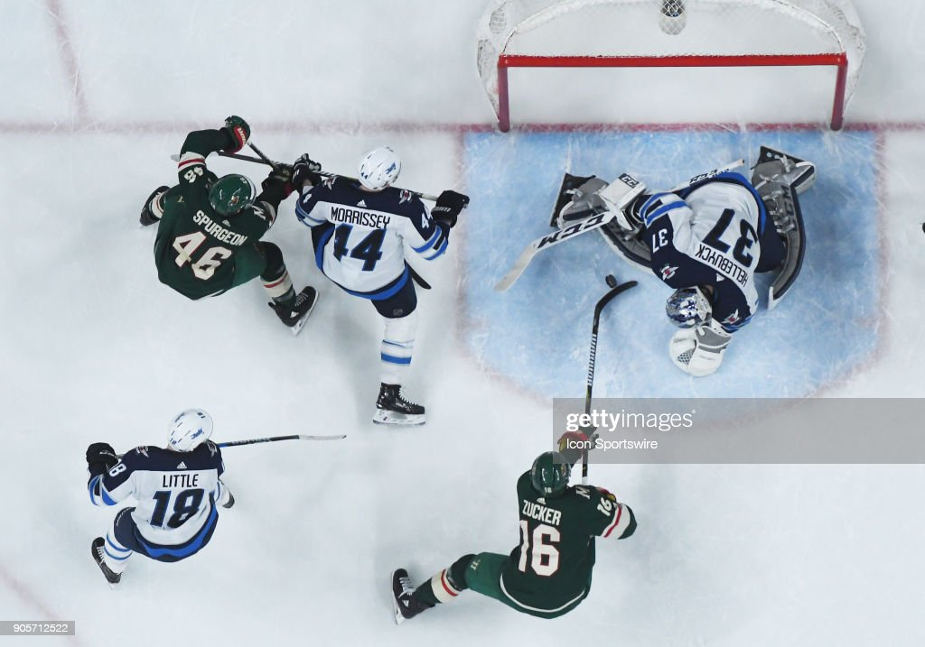 Minnesota Wild Defenceman Jared Spurgeon (46) and Winnipeg Jets Defenceman Josh Morrissey (44) battle as Minnesota Wild Left Wing Jason Zucker (16) is stopped by Winnipeg Jets Goalie Connor Hellebuyck (37) as Winnipeg Jets Center Bryan Little (18) enters the play during a NHL game between the Minnesota Wild and Winnipeg Jets on January 13, 2018 at Xcel Energy Center in St. Paul, MN. The Wild defeated the Jets 4-1.
