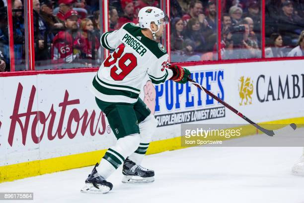 Minnesota Wild Defenceman Nate Prosser passes the puck out from behind the net during first period National Hockey League action between the...