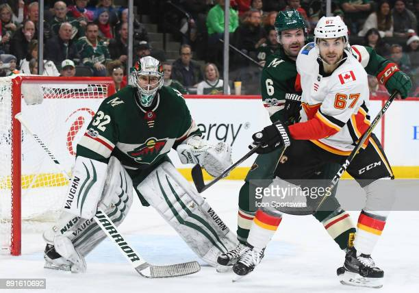 Minnesota Wild Defenceman Ryan Murphy and Calgary Flames Right Wing Michael Frolik battle in front of Minnesota Wild Goalie Alex Stalock during a NHL...